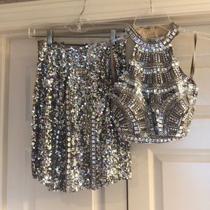 Scala Silver Halter top and sequined skirt.
